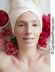 Spa flowers relaxing massage theraphy. Female thirty to fourty years