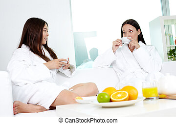Spa friends - Attractive girls in bathrobes relaxing in spa...