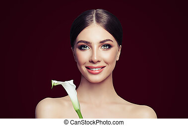 Spa girl portrait. Perfect young woman with healthy skin and flower