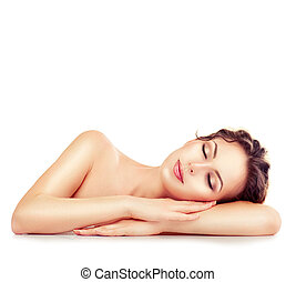 Spa girl. Sleeping or resting female isolated on white background