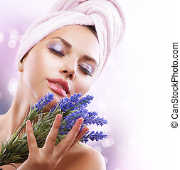 Spa Girl with Lavender Flowers. Beautiful Young Woman After Bath