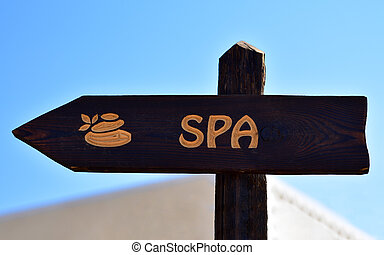 Spa inscription on wooden sign on the hotel territory