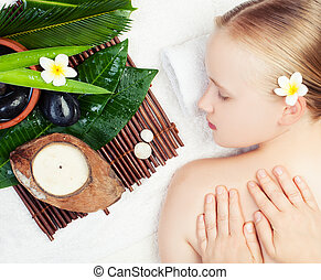Spa massage concept. Beautiful young woman getting spa massage. Top view
