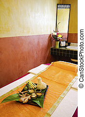 Spa massage setting with thai herbal compress stamps in spa...