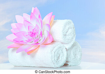 Spa. Towels with lotus flower. Body care.