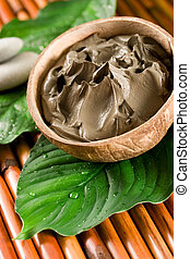 Spa mud - Black mud in an organic bowl. Spa, beauty concept.