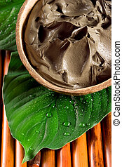 Spa mud - Close-up of a mud in a bowl. Spa, beauty concept.