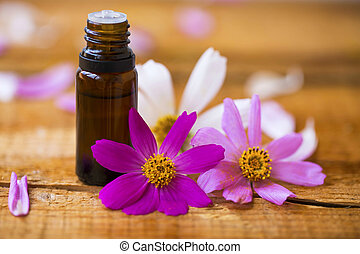 Spa natural essential oil bottle with flowers