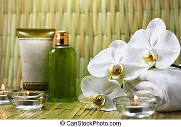 Orchid, candles and body care products in the spa