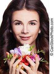 Spa Portrait of Cute Woman with Colorful Flowers in Her Hands