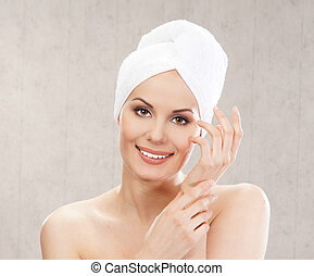 Spa portrait of young attractive woman in towel