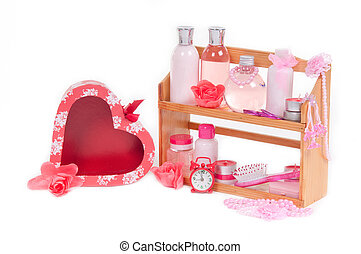 SPA present and red heart shaped gift box isolated on white