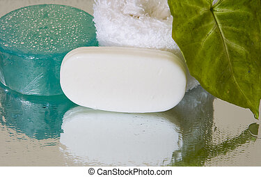Spa beauty products, with reflection and water droplets