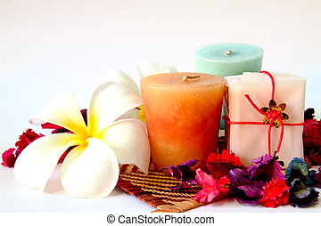 Spa products with flowers and candles