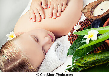 Spa relax massage concept. Beautiful young woman getting spa massage
