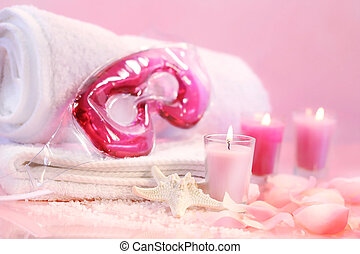 Spa relaxation for the eyes with pink candles and towels