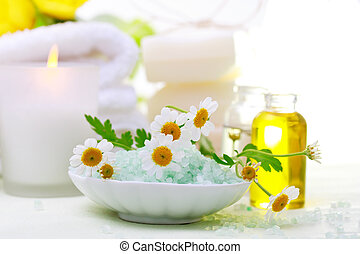 Spa relaxation theme with flowers, bath salt, essential oil and candles
