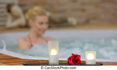 Spa resort jacuzzi hot tub woman. Happy woman relaxing in...