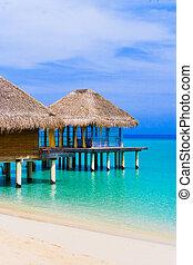 Spa salon on beach of tropical island - travel background