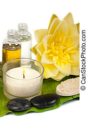 Spa scene with water lily and massage oils