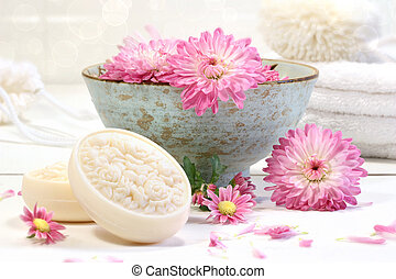 Spa scene with pink  flowers in water