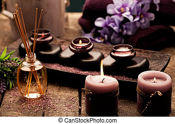 Spa Setting - Candles, aromatherapy oil and hot stones used...