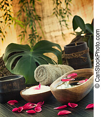 Spa setting - Natural spa setting with rose water and towel.
