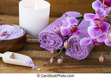 Spa setting still life with orchid, towels and salt