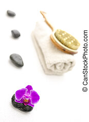 Spa setting with pink orchid