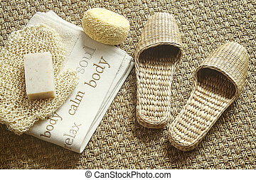 Spa setting with slippers, towel and soap