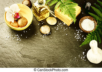 Spa setting with soap bar, herbal massage ball and essential...