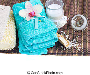 spa settings with blue towels and aroma candle