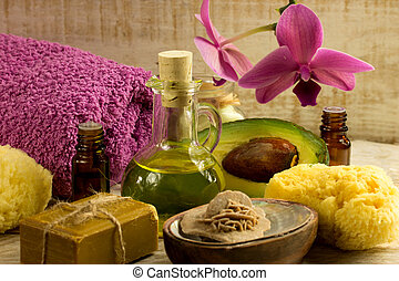 Spa wellness products -orchid ,stones, towel, bowl of Spa salt