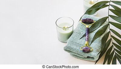 Spa stil life - Spa still life with amethyst roller, candle,...