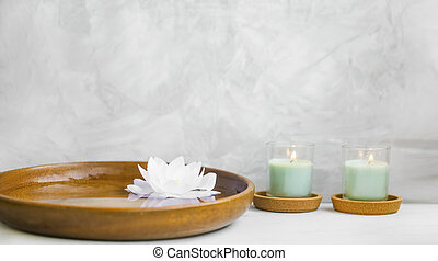 Spa stil life - Spa still life with candles and water lily,...