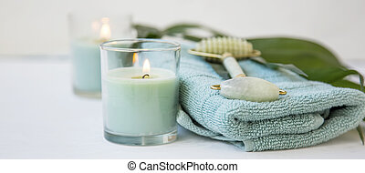 Spa stil life - Spa still life with jade roller, candles,...