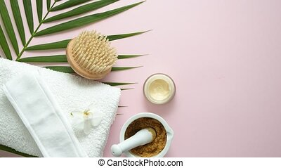 Spa still life composition. White towel and tropical palm ...