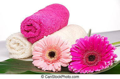 Spa still life with aromatic candles, flower and towel