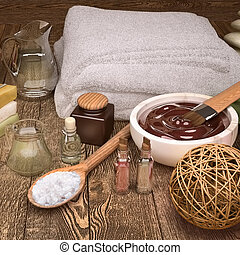 Spa still life with candles, spa products and wicker ball.