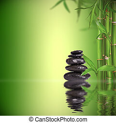 Spa still life with lava stones and bamboo sprouts with free space for text
