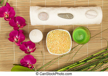 Spa still life with Orchid, candle, salt and towel bamboo