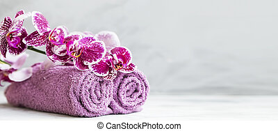 Spa still life with orchid flower and cotton towels