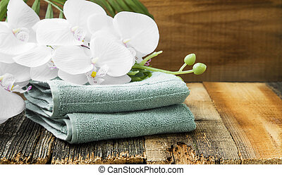Spa still life with orchid flowers and soft towels