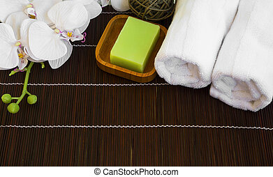 Spa still life with orchid, natural soap and towels