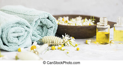 Spa still life with towels and chamomile flowers