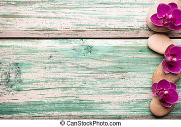 Spa. - Spa stones on wooden background with orchids.