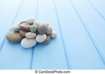 Spa stones on table light background