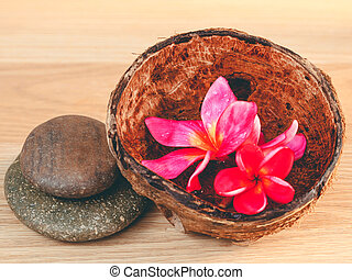 Spa stones with frangipani flower. - Concept for spa and meditat