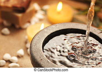 Spa theme. Pouring water for spa treatment.
