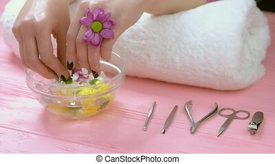 Spa therapy for hands, slow motion. Beautiful female hands...